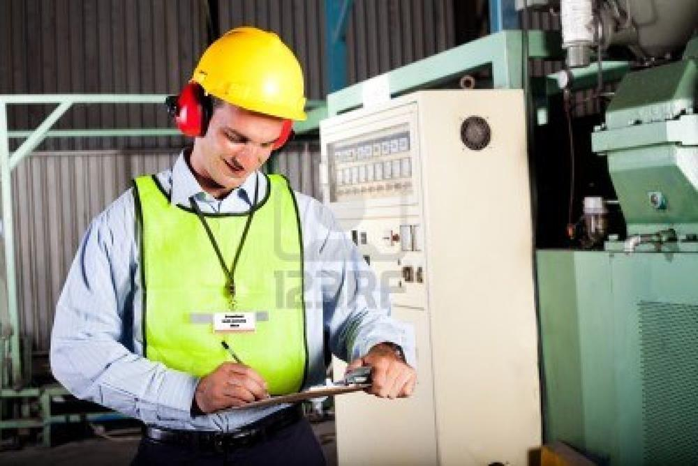 12431527-male-occupational-health-and-safety-officer-inside-factory-doing-inspectionss
